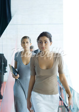 Businesswomen walking toward camera Stock Photo - Premium Royalty-Freenull, Code: 695-03374203