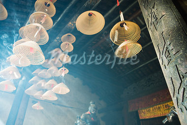 Incense burning in Chinese temple, low angle view Stock Photo - Premium Royalty-Freenull, Code: 696-03394956