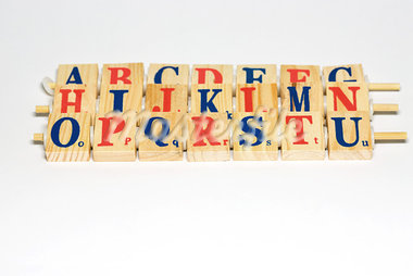 Wooden alphabet blocks lined up, close-up Stock Photo - Premium Royalty-Freenull, Code: 696-03395699