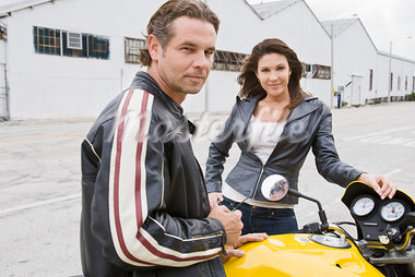 Portrait of Couple Standing next to Motorcycle Stock Photo - Premium Rights-Managed, Artist: Kevin Dodge, Code: 700-03406469