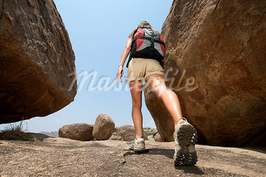 Woman hiking in rocky terrain Stock Photo - Premium Royalty-Freenull, Code: 614-03419863