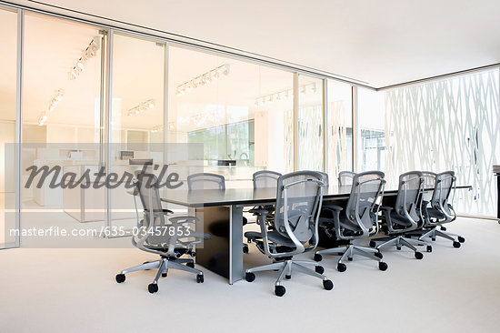 Empty, modern conference room with glass walls - Stock Photos