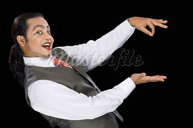 Close-up of a mime performing magic trick Stock Photo - Premium Royalty-Freenull, Code: 630-03480595