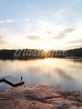 Boy Fishing from Dock at Sunset Stock Photo - Premium Rights-Managed, Artist: Andrej Kopac, Code: 700-03502973