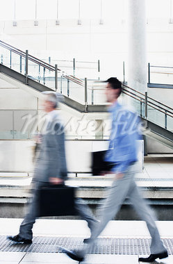 Businessmen rushing on train platform Stock Photo - Premium Royalty-Freenull, Code: 635-03515629