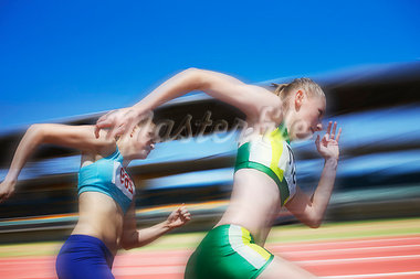 Runners competing on track Stock Photo - Premium Royalty-Freenull, Code: 635-03516319