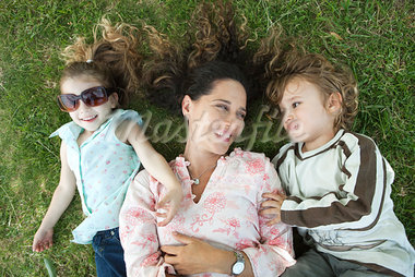 Mother lying on grass with young children Stock Photo - Premium Royalty-Freenull, Code: 632-03517005