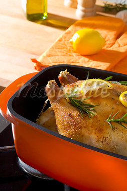 Roast chicken with rosemary and lemon Stock Photo - Premium Royalty-Freenull, Code: 659-03522623