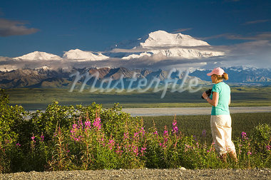 Young woman tourist views Mt.McKinley and the Alaska Range in Denali National Park Alaska summer Stock Photo - Premium Rights-Managed, Artist: AlaskaStock, Code: 854-03538134