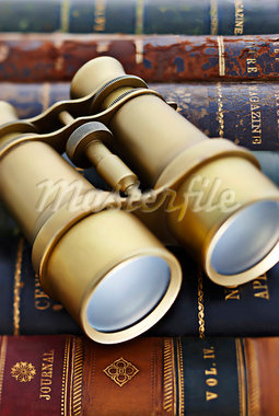 Close-up of Binoculars on Leather Bound Books Stock Photo - Premium Rights-Managed, Artist: David Muir, Code: 700-03553408