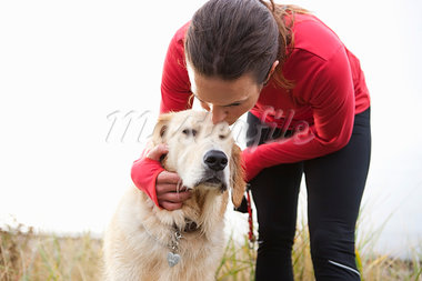Woman Kissing Dog in Discovery Park, Seattle, Washington, USA Stock Photo - Premium Rights-Managed, Artist: Ty Milford, Code: 700-03554504