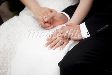Close-up of Bride and Groom Holding Hands Stock Photo - Premium Rights-Managed, Artist: Ikonica, Code: 700-03567845