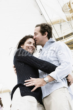 Mid adult man kissing on forehead of a mid adult woman Stock Photo - Premium Royalty-Freenull, Code: 618-03570946