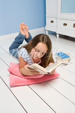 Girl Lying on Floor Reading Book Stock Photo - Premium Rights-Managed, Artist: Ursula Klawitter, Code: 700-03615824