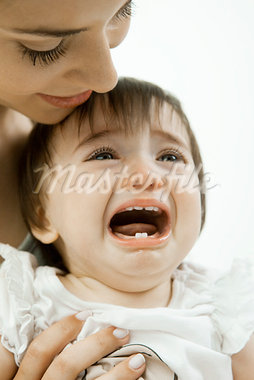 Mother holding crying infant Stock Photo - Premium Royalty-Freenull, Code: 632-03630091