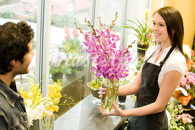 Florist Employee Arranging Flower Display Stock Photo - Premium Royalty-Freenull, Code: 618-03631096