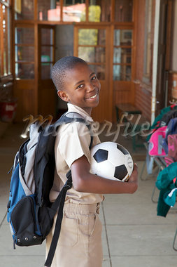 Portrait of a smiling schoolboy with his soccer ball, KwaZulu Natal Province, South Africa Stock Photo - Premium Royalty-Freenull, Code: 682-03643925