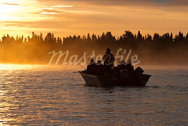 Silhouette of men fishing at Sunrise near the mouth of the Kenai River, Kenai Peninsula, Southcentral Alaska, Summer Stock Photo - Premium Rights-Managed, Artist: AlaskaStock, Code: 854-03645860