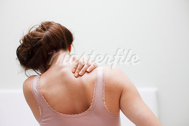 Woman rubbing aching back Stock Photo - Premium Royalty-Freenull, Code: 635-03685390