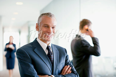 Businessman standing in busy office Stock Photo - Premium Royalty-Freenull, Code: 635-03685645