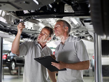 Mechanics working underneath car Stock Photo - Premium Royalty-Freenull, Code: 635-03716502