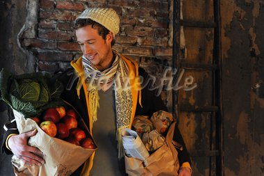 Man carrying shopping bags with produce Stock Photo - Premium Royalty-Freenull, Code: 689-03733434