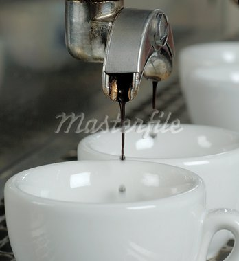 Espresso flowing into cup Stock Photo - Premium Royalty-Freenull, Code: 689-03733772