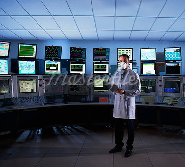 Scientist monitoring computers in control room Stock Photo - Premium Royalty-Freenull, Code: 635-03752457
