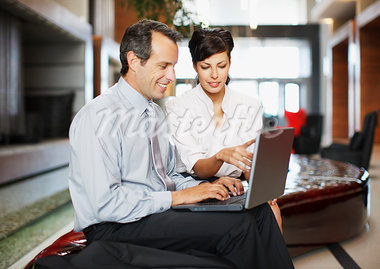 Business people working together in hotel lobby Stock Photo - Premium Royalty-Freenull, Code: 635-03752702