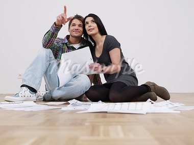 Couple sitting in empty flat Stock Photo - Premium Royalty-Freenull, Code: 649-03775237