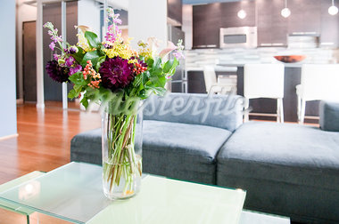 Interior of modern living room with flowers on coffee table Stock Photo - Premium Royalty-Freenull, Code: 635-03781635