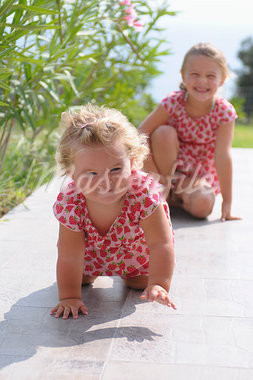 Sisters on Tiled Patio Stock Photo - Premium Rights-Managed, Artist: Pascal Albandopulos, Code: 700-03836237