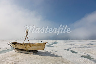 Inupiaq Eskimo Skin Boat (Umiaq) made from bearded seal skin resting on the shore ice of the Chukchi Sea off shore of Barrow, Arctic Alaska, Summer Stock Photo - Premium Rights-Managed, Artist: AlaskaStock, Code: 854-03845480