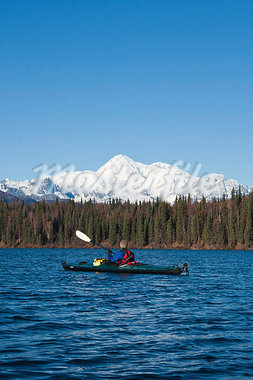 Woman kayaking in Byers Lake with scenic view of Mt. McKinley on a clear sunny day, Denali State Park, Southcentral Alaska, Autumn Stock Photo - Premium Rights-Managed, Artist: AlaskaStock, Code: 854-03845980