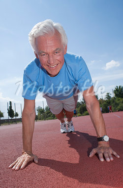 Man Exercising Outdoors on Track Stock Photo - Premium Royalty-Free, Artist: KL Services, Code: 600-03848779