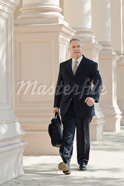 Businessman Walking Stock Photo - Premium Rights-Managed, Artist: Kevin Dodge, Code: 700-03848837
