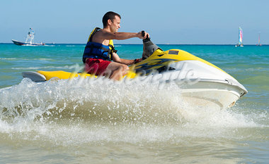 Man on Personal Watercraft Stock Photo - Premium Royalty-Free, Artist: KL Services, Code: 600-03849567