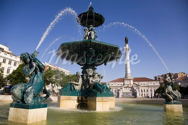 Water from the Rossio fountain appears to be arching over the statue of Dom Pedro IV at the square named after him in Lisbon, Portugal, Europe Stock Photo - Premium Rights-Managed, Artist: Robert Harding Images, Code: 841-03871399