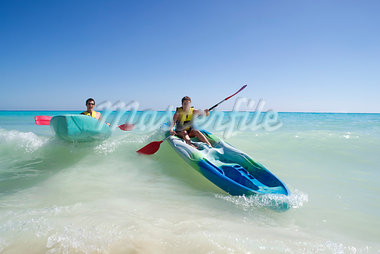 Couple Kayaking, Reef Playacar Resort and Spa, Playa del Carmen, Mexico Stock Photo - Premium Royalty-Free, Artist: KL Services, Code: 600-03891044