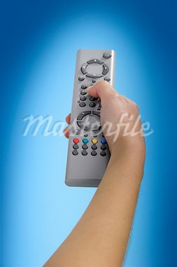 Human hand olding a tv remote control Stock Photo - Royalty-Free, Artist: iko, Code: 400-03915490