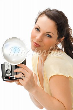 Young beautiful smiling woman holding a photo camera and making face while is shooting Stock Photo - Royalty-Free, Artist: carlodapino, Code: 400-03917525