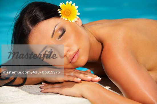 Beautiful young Sexy woman laying during sunbath next to swimming pool Stock Photo - Royalty-Free, Artist: dash, Code: 400-03919973