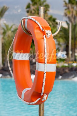 Lifebuoy in a pretty swimming pool with the blue water Stock Photo - Royalty-Free, Artist: Gelpi, Code: 400-03920272