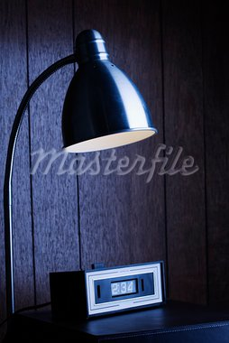 Dim desk lamp and retro clock against wood paneling at night. Stock Photo - Royalty-Free, Artist: iofoto, Code: 400-03923608