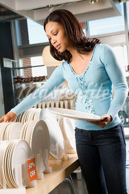 African American female shopping for plates in retail setting. Stock Photo - Royalty-Free, Artist: iofoto, Code: 400-03924715