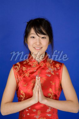 Beautiful young Asian girl posing for a portrait wearing a China Dress Stock Photo - Royalty-Free, Artist: dndavis, Code: 400-03929831