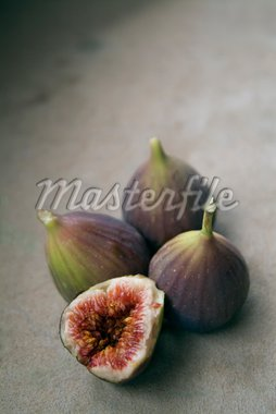three figs and a slice Stock Photo - Royalty-Free, Artist: Noam, Code: 400-03930719