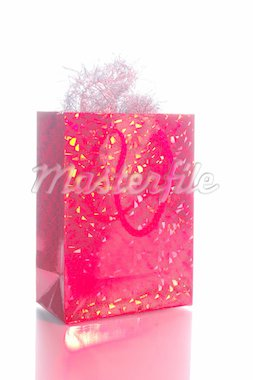 Glittering gift bag with sparkling Christmas tinsel decorations. Studio shot isolated on white background. Stock Photo - Royalty-Free, Artist: alexh, Code: 400-03933726