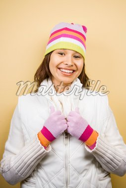 Young adult Caucasian woman wearing winter hat and gloves and smiling at viewer. Stock Photo - Royalty-Free, Artist: iofoto, Code: 400-03937655