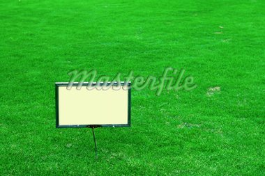 A blank sign board on the green lawn Stock Photo - Royalty-Free, Artist: ti_to_tito, Code: 400-03938482